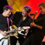 Mick Dallavee having a good time on stage with Bruce Greenwood, and Don Felder.